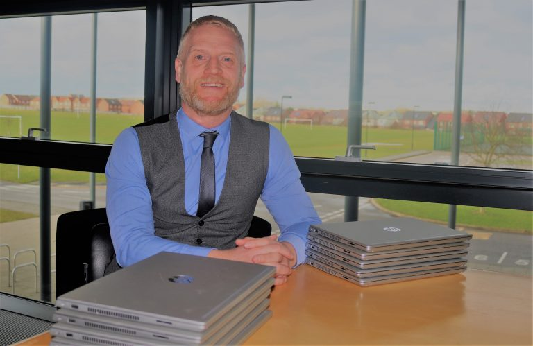 Developer donates laptops to Corby Business Academy